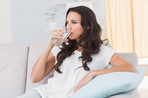 5 avoid bridal beauty disasters - woman drinking water