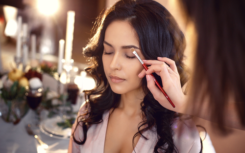 7 avoid bridal beauty disasters - bride getting makeup done