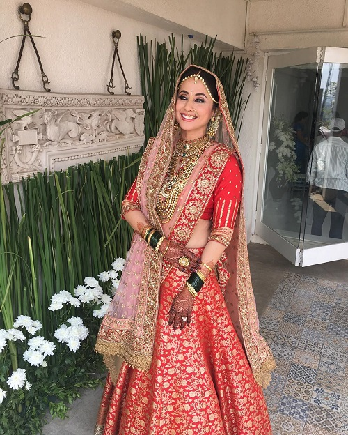 2 red bridal lehengas