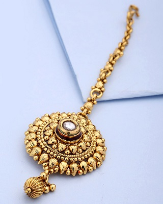 9 gold plated maang tikkas