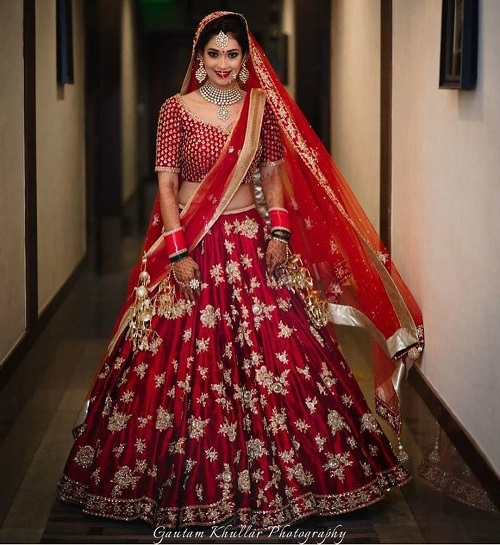 6 red bridal lehengas