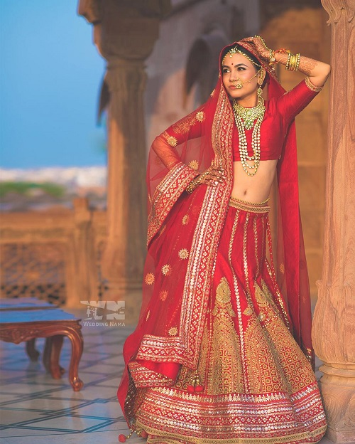 8 red bridal lehengas