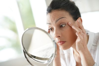 Understanding your skin type Pimple Removal Cream how to get rid of pimples Understanding your skin type, girl looking in the mirror