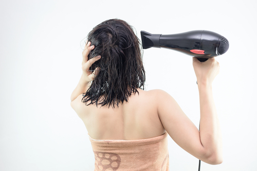18 not do to your hair in your 20s - do not blow dry wet hair