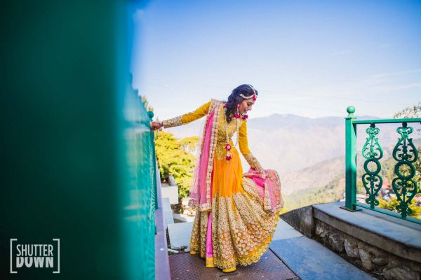 4 destination wedding brides pose
