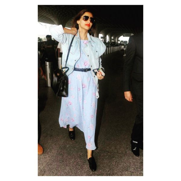 1. Sonam Kapoor airport look rheson blue and pink dress