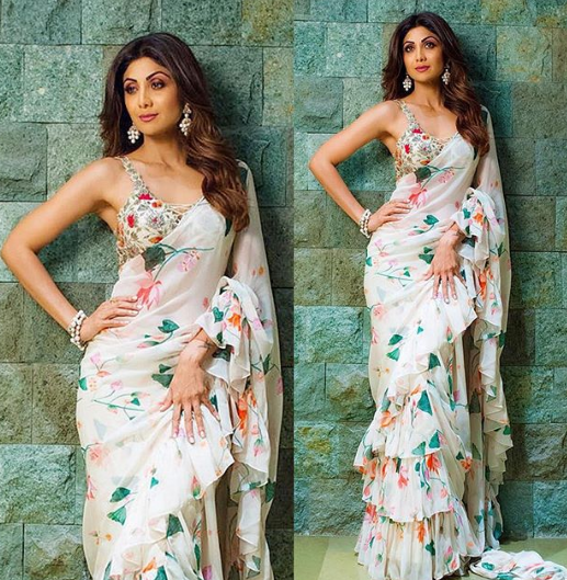1 shilpa shetty floral saree wine red pink purple eye makeup posting against green wall instagram picture