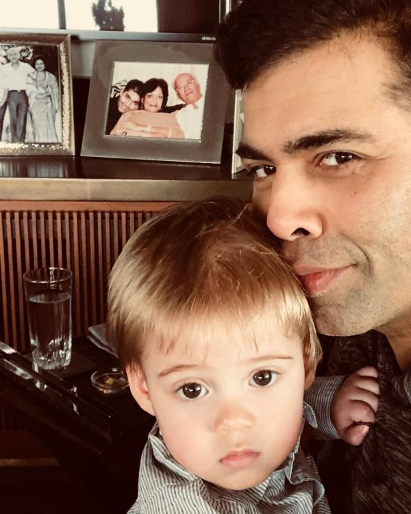 Karan Johar hugging his son Yash