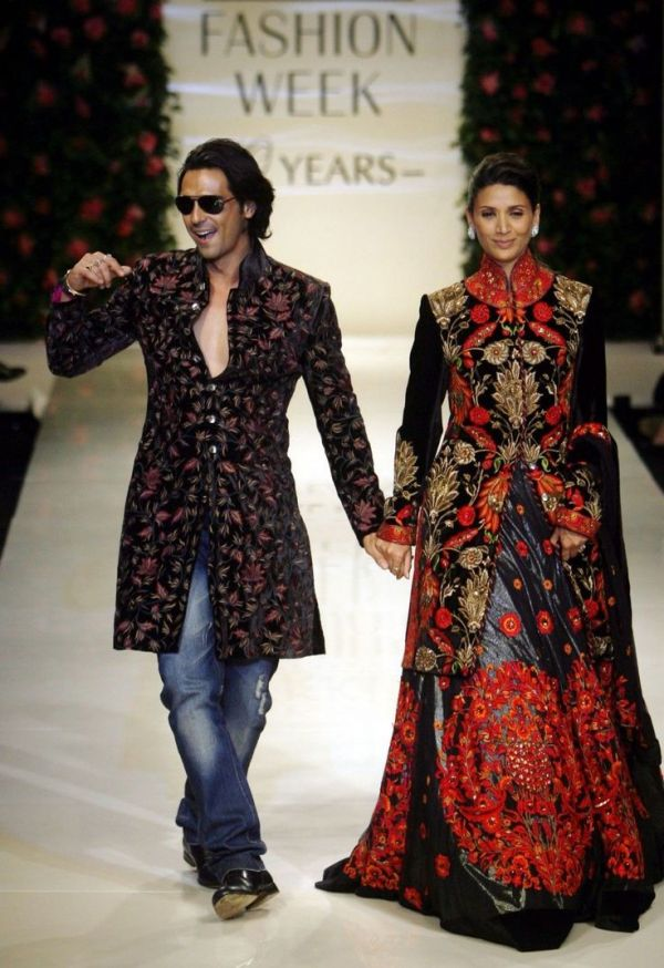 arjun rampal and mehr jessia walking the ramp