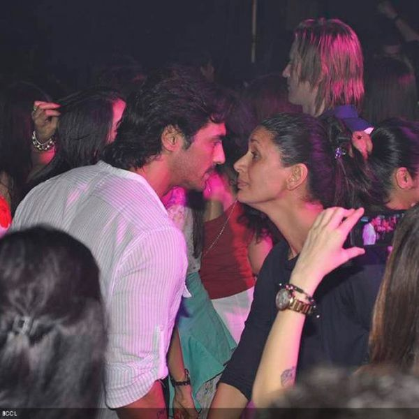 arjun rampal and wife mehr jessia at a party
