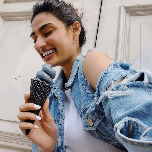 5 athiya shetty messy bun london vacation