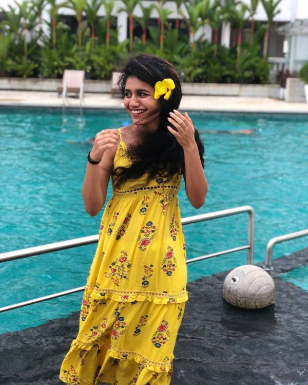 4 priya prakash varrier - yellow flower and dress