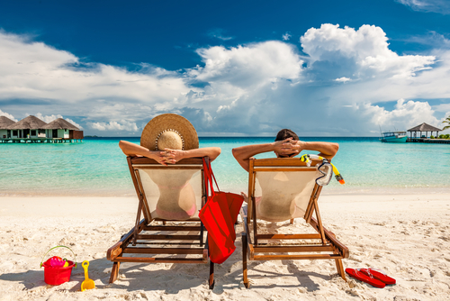1 couple sitting at a beach in maldives