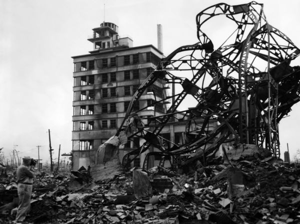 The blasted Chuguko Press building along Hiroshima's main street shortly after the blast. %28far left%29. This building withstood the force of the bomb  but the interior was gutted. ca 1945