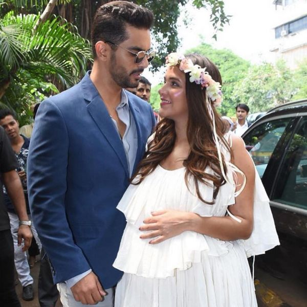3 - angad bedi lookfing at neha -neha dhupia looks like an angel at baby shower
