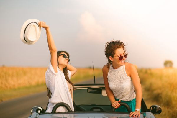 all you need to know about pisces women - girls having fun while travelling