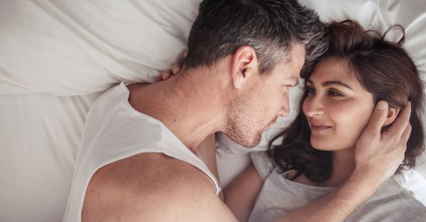 all you need to know about pisces women - pisces woman in bed with her partner