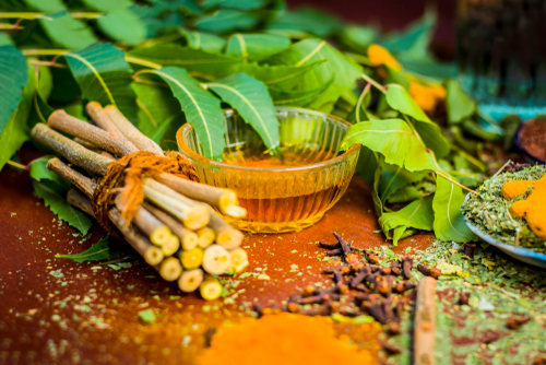 drink turmeric and neem tea to reduce breast size naturally