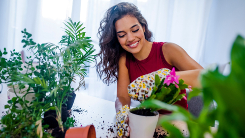 brunette watering plants and plants are good for skin