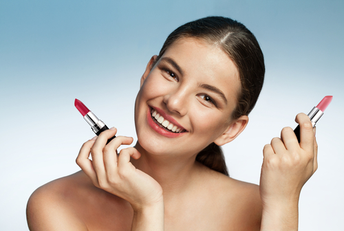 lipstick as blush  lipstick hacks  makeup products girl holding two lipsticks