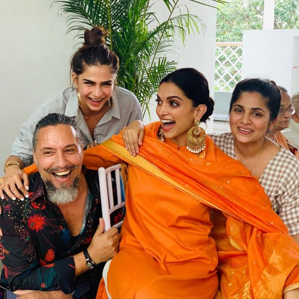 5-deepika-padukone-orange-suit-forpre-wedding-pooja