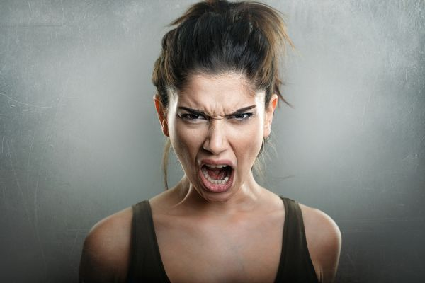 Copy of bigstock-Scream-of-angry-upset-young-wo-125335583