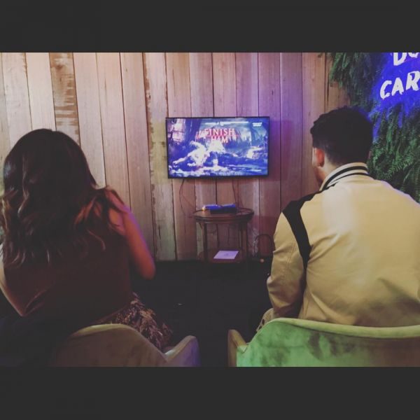 13-NickYanka-Candid-Pics-playing-mortal-kombat-in-mumbai