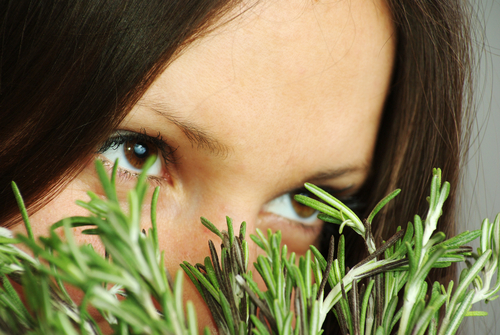 woman-sniffing-rosemary-leaves