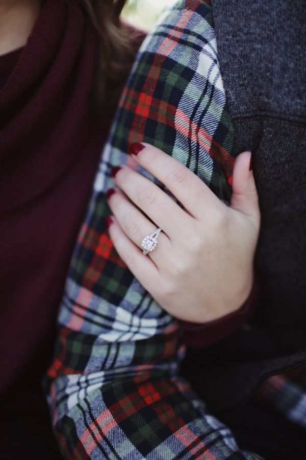 1-engagement-ring-guide-couple-holding-hands