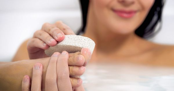 Woman using a pumice stone-1200x628-facebook