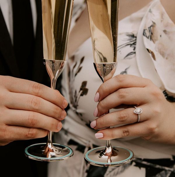 brides-flaunting-engagement-rings-holding-glasses