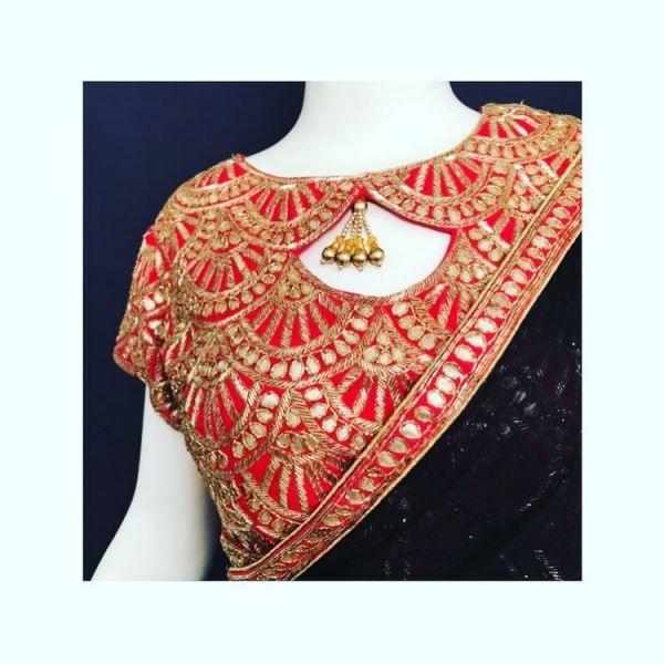 black georgette sari is paired with a gorgeous designer gotta blouse