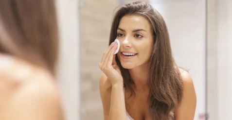 6 Everything You Need To Know About Acne  Acne Scars - girl cleaning her face