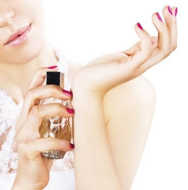 12. beauty industry buzz words and industry terms - girl applying perfume