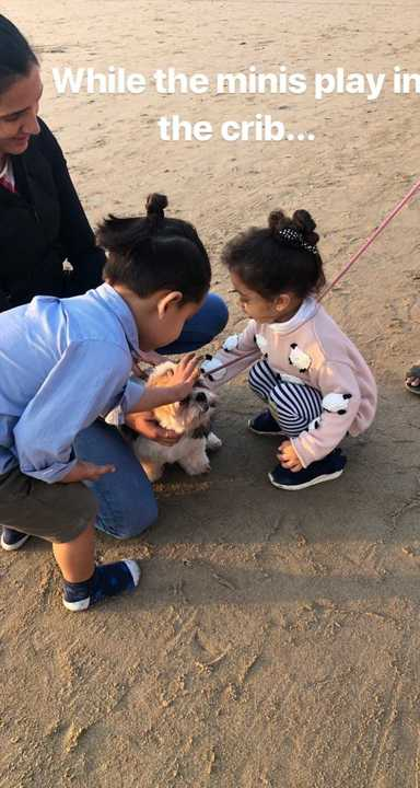 4-misha-kapoor-playing-with-dog-at-beach