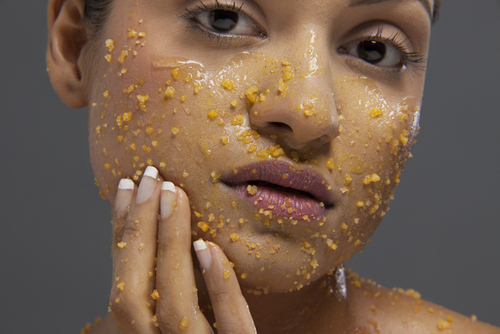 woman-exfoliating-face