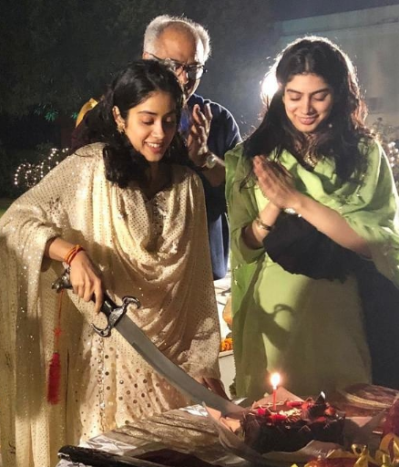 1-janhvi-kapoor-cuts-cake-with-a-sword