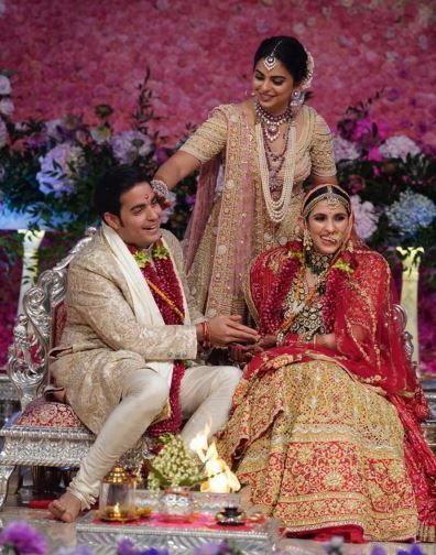 1 Ambani Family s Nayi Bahu Shloka Looked Like A Million Bucks As A Bride - akash ambani  isha ambani and shloka mehta