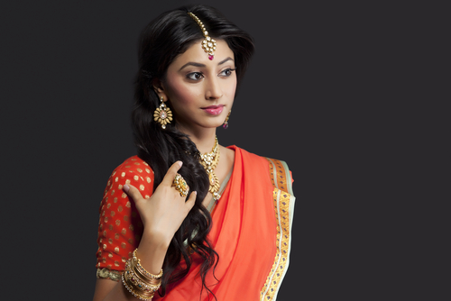 9 tips to wear a saree - indian woman in orange saree