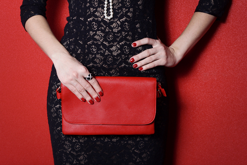 Internal. I Went Commando - women holding a clutch