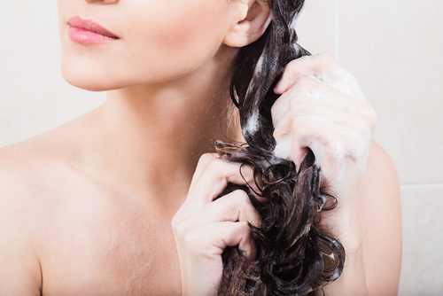 woman twisting damp hair