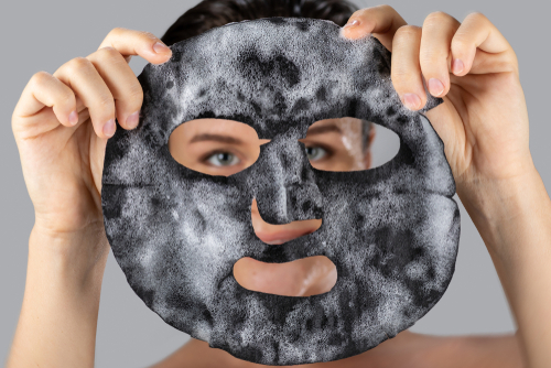 woman with sheet mask