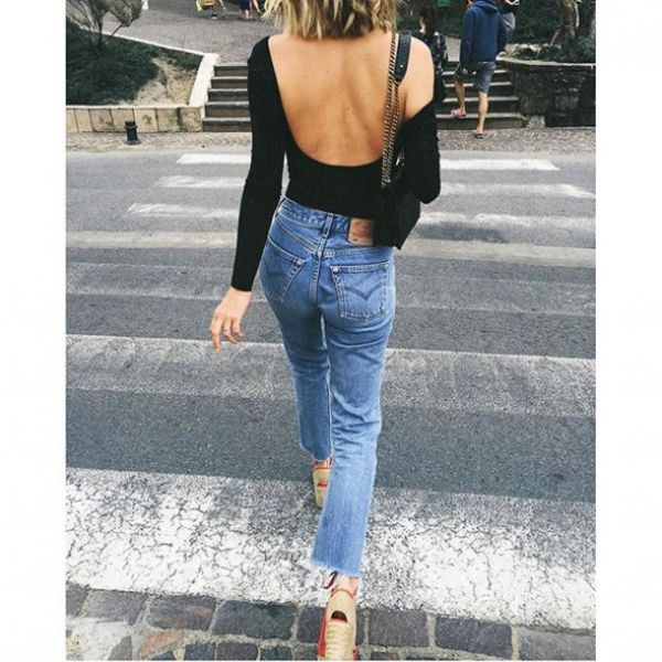 backless top with blue jeans