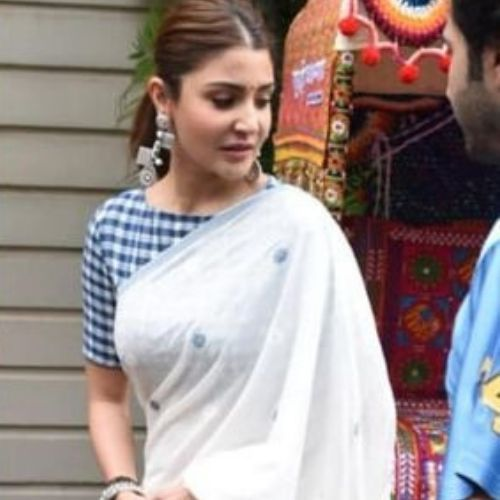 Anushka Sharma wearing classic blue color closed neck blouse with white saree