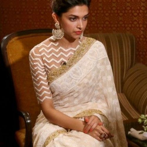deepika padukone wearing aztec printed high neck blouse with off white saree