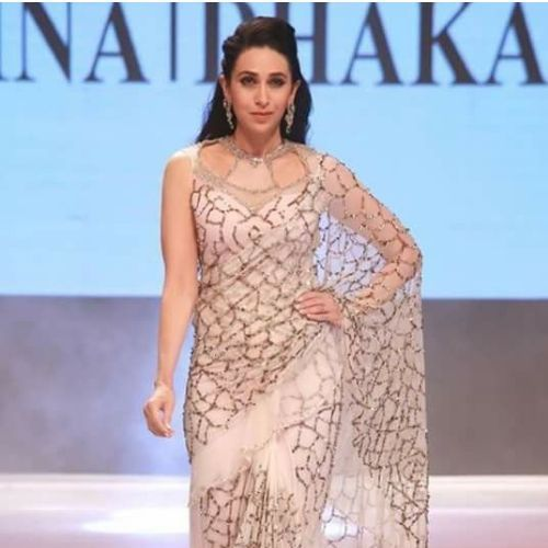 Karisma kapoor in high neck saree blouse