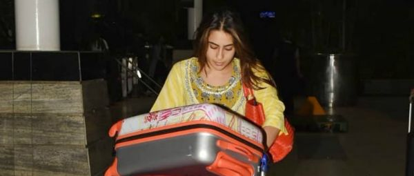 Sara Ali Khan Carries Her Luggage At The Airport & Trolls Ask, 'Why Is This News?'