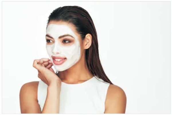 Girl put face pack on face