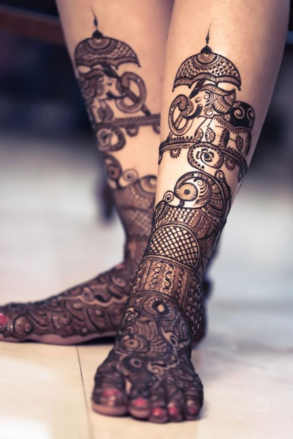 Elephant, peacock, and flower design mehndi on feet