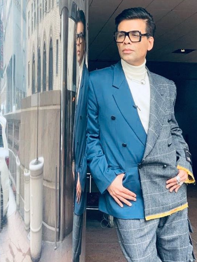 karan johar wearing two suits in one